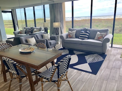 Living/Dining Area with Floor to Ceiling Windows and Ocean View