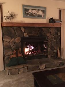 Photo of our beautiful log burning fireplace.