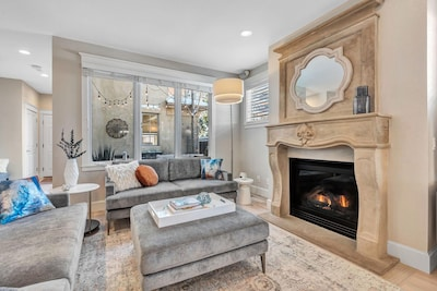 Open concept Living Room with Gas fireplace and flat screen tv