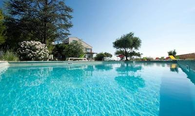 piscine 15x7 avec palissade sécurisée