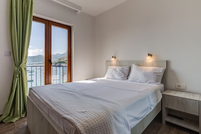 Bright bedroom with king size bed and amazing view