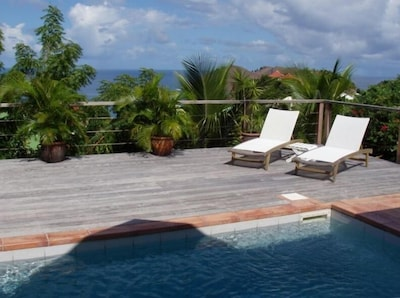 Extensive Pool-Side Deck Ideal for Sunning and Entertaining