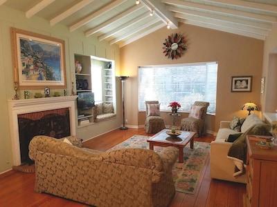 Spacious living room has plenty of seating.
