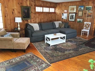Beautiful open living area with brand new sofa