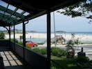 View of beach from front wrap - around porch