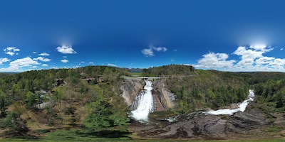 Panoramic Picture taken by drone of waterfall and condo building (middle bldg)