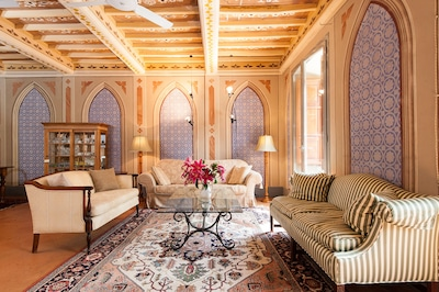 Elegant and spacious living room with windows on the piazza