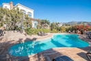 A good sized private swimming pool set in front of this six bedroom villa, with plenty of patio area surrounding