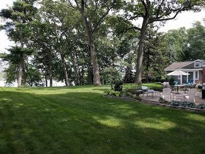 backyard and patio looking towards lake