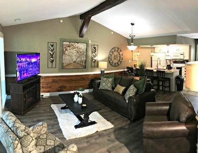 Open Spaced Living Room With Sleeper Sofa , HDTV, and Fireplace