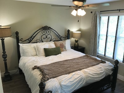 Master Bedroom With King Bed, HDTV and Adjoining Bathroom