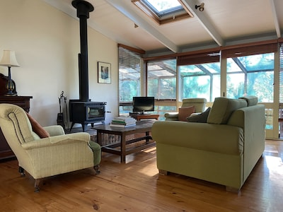 Cosy fireplace in open-plan living room