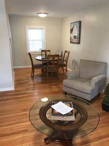 Living room to dining area with marble top table and area info stand!