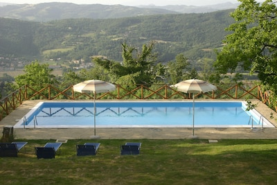 The 12 metre x 6 metre pool with fantastic views across the valley
