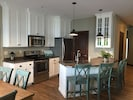 Fully furnished kitchen.  Peninsula seats 4, large counter, d/w not shown.
