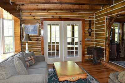 Large cozy sitting room with access to large screened in porch.