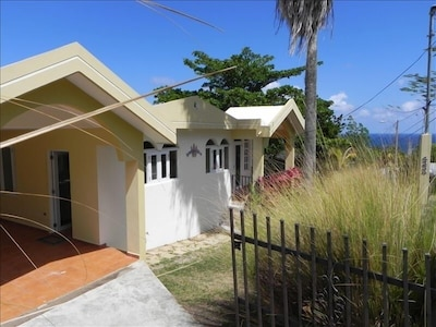 View of the Front of Surf View Villa with the Ocean in the Background