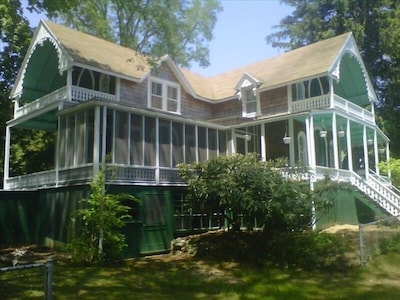4 Bedrooms, 2.5 baths, parlor, living room, kitchen, dining room, four porches