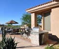 Built-in BBQ, Lunch Bar and Mini-Fridge.  Wrought Iron Patio Furniture.