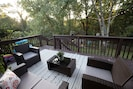 Enjoy the privacy of the back deck as you lounge in the outdoor patio furniture