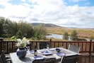 Patio dining area with a view of the river.