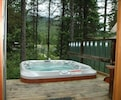 Hot tub on the deck overlooking the lake