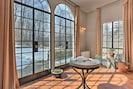 Arched doorways and stone accents highlight this historic 1920's home.