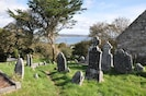 Ardmore - the view over the grave stones of the old church and over the cliffs