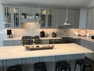 Gourmet kitchen with farm sink, subway backsplash, ss appliances, and much more!