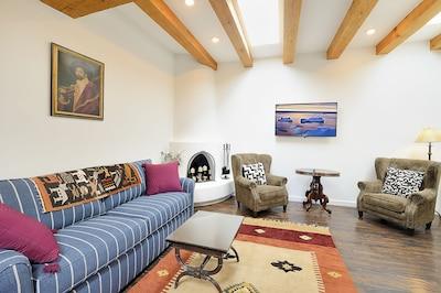 Living room with wood burning kiva fireplace