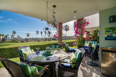 Covered patio overlooking golf course/ocean views, great alfresco dining.