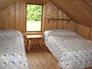 Upstairs Bedroom has Two Double Beds.