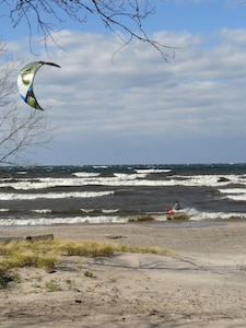 Windy day excitement on the shore of Lake Ontario on our guests' private beach.
