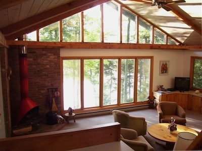 Enjoy the panoramic view of the water from the living room.