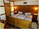 Bauernhaus Ferien – 48m² mit Kaminofen-Schlafzimmer