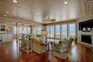 """Beautiful main living room, with ocean view, 70"""" TV, fireplace and bar"""