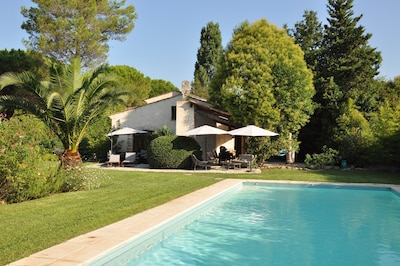 Provincial style villa with landscaped garden and  large  covered swimming pool