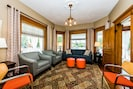 Beautifully furnished parlor with a view of Journeyman Distillery.