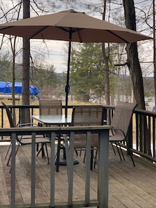 Back deck with patio set with 6 chairs and propane gas Weber grill