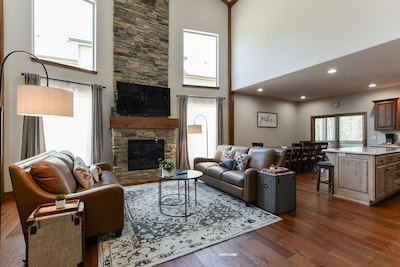 Living room showcase floor to ceiling stone fireplace leather sofas #Joyfullodge