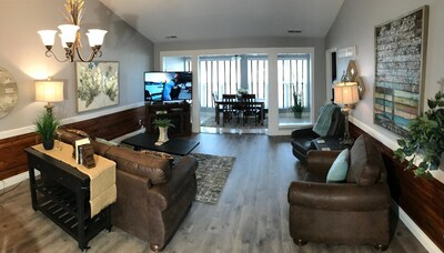 Cheerful Living Area With Sleeper Sofa, HDTV, and Fireplace