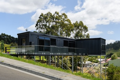 New elevated container house with stunning rural and ocean views