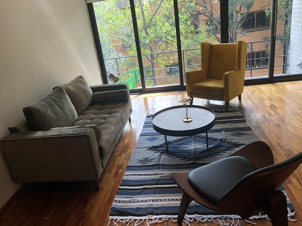 VRBO Mexico City: Modern style living room with sofa, chairs and large windows