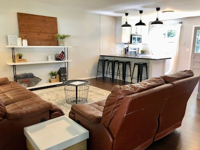 Super comfy yet stylish living area that is open to the kitchen area.