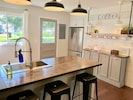 You'll love the open concept, fully stocked kitchen!
