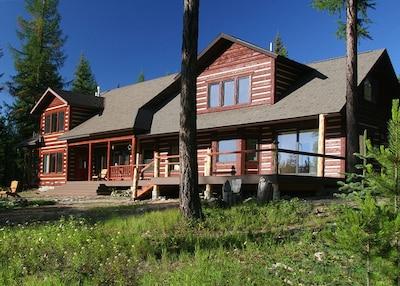 Lupine Meadow Lodge.  Glacier's peaks reflect in the windows.