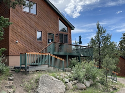 Exterior of Cabin, deck with area with natural gas grill and patio set