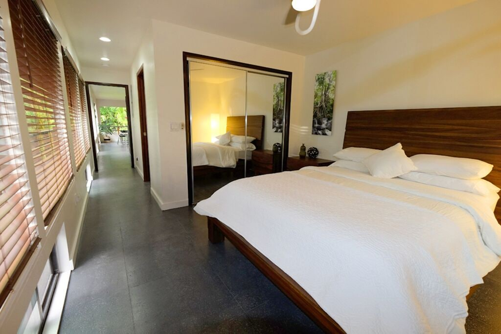 Neutral interior of the bedroom in a rental house in Hawaii