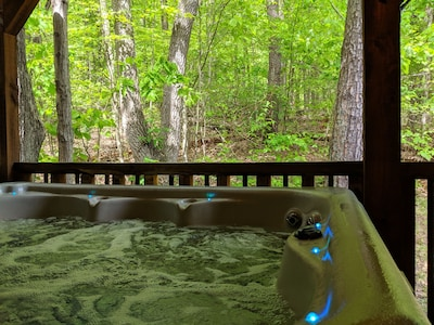 6 person hot tub with waterfall and led lights.