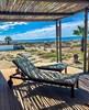 The ground floor patio with sun loungers & ocean views (photo: J.vanTonder)